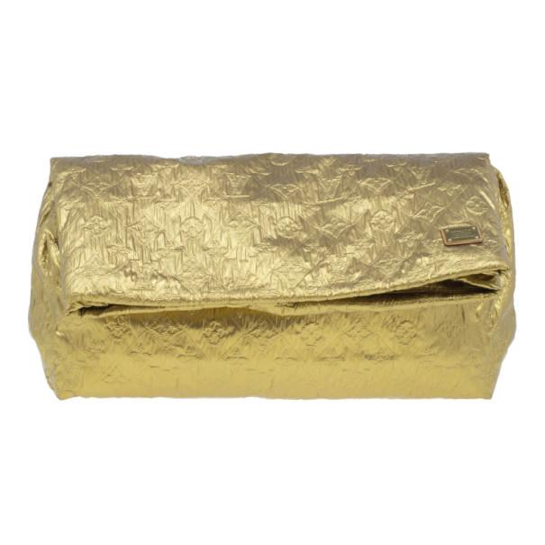 bac48c37f89 ... Louis Vuitton Gold Monogram Cowhide Leather Limelight Clutch GM.  nextprev. prevnext