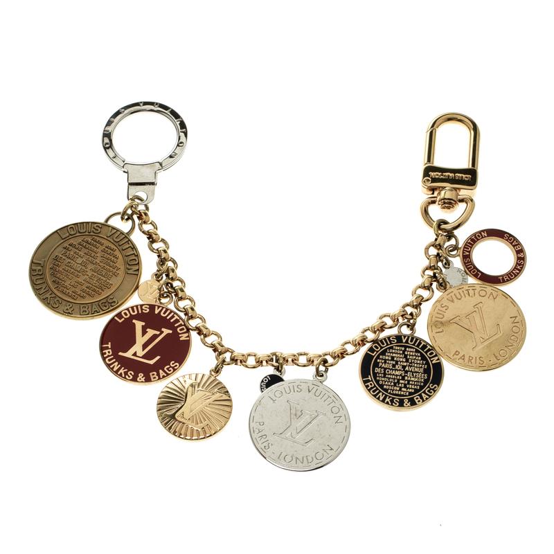 79295ead35bc ... Louis Vuitton Trunks And Bags Enamel Gold Tone Bag Charm. nextprev.  prevnext