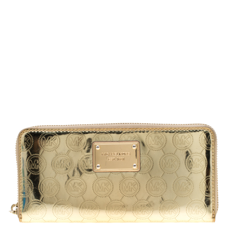 555462a820af ... Michael Kors Gold Patent Leather Jet Set Zip Around Wallet. nextprev.  prevnext