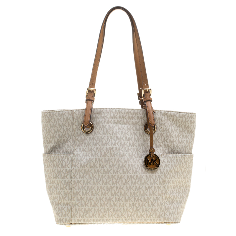 d7e3b25d8 ... Michael Michael Kors Off White Signature Canvas Jet Set Tote. nextprev.  prevnext