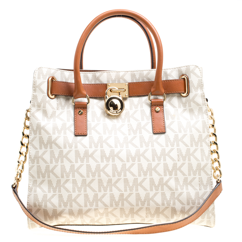b7c7e4178c0a ... Michael Michael Kors Cream Brown Coated Canvas and Leather East West  Hamilton Tote. nextprev. prevnext