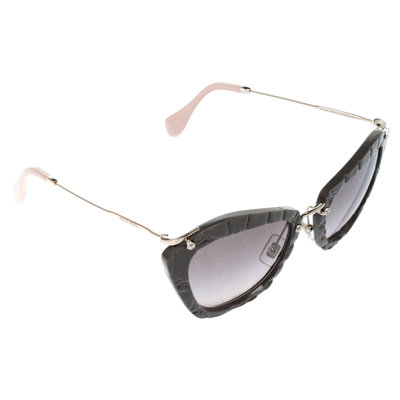 b57dc7c930a6 Buy Miu Miu Grey SMU 10N Cat Eye Sunglasses 130484 at best price