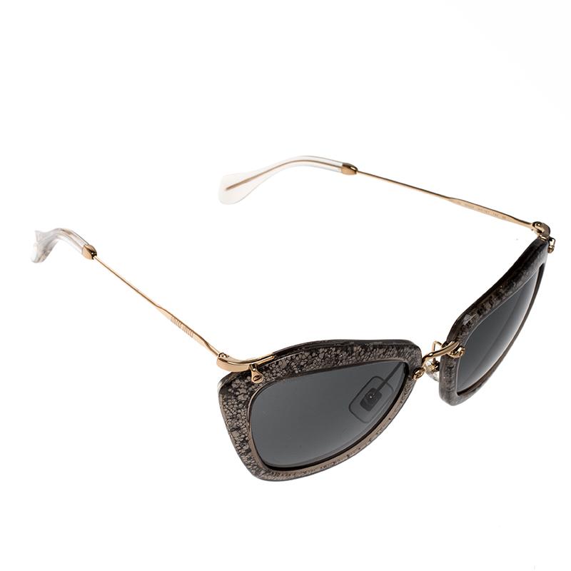 3a2e66b2f840 ... Miu Miu Grey Glitter Black SMU10N Cat Eye Sunglasses. nextprev. prevnext