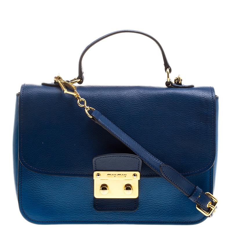 5c7187c56a0 ... Miu Miu Blue Leather Madras Top Handle Crossbody Bag. nextprev. prevnext
