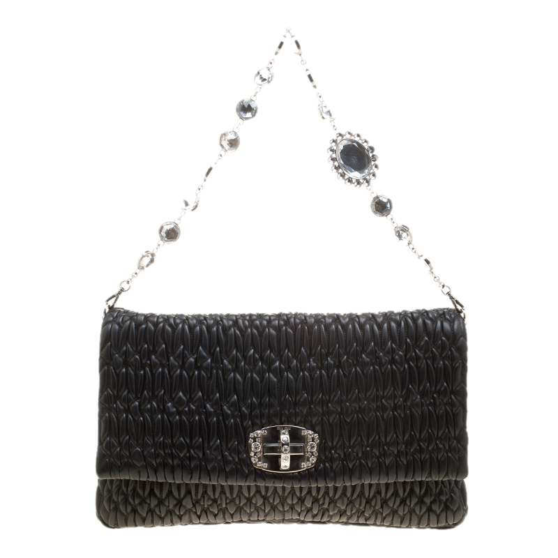 ad1d1601cd30 ... Miu Miu Black Matelassé Leather Crystal Flap Shoulder Bag. nextprev.  prevnext