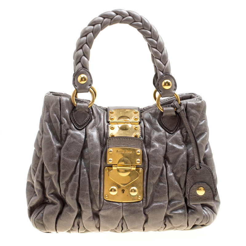 ... Miu Miu Grey Matelasse Leather Coffer Two Way Top Handle Bag. nextprev.  prevnext a3be2e8da7ccd