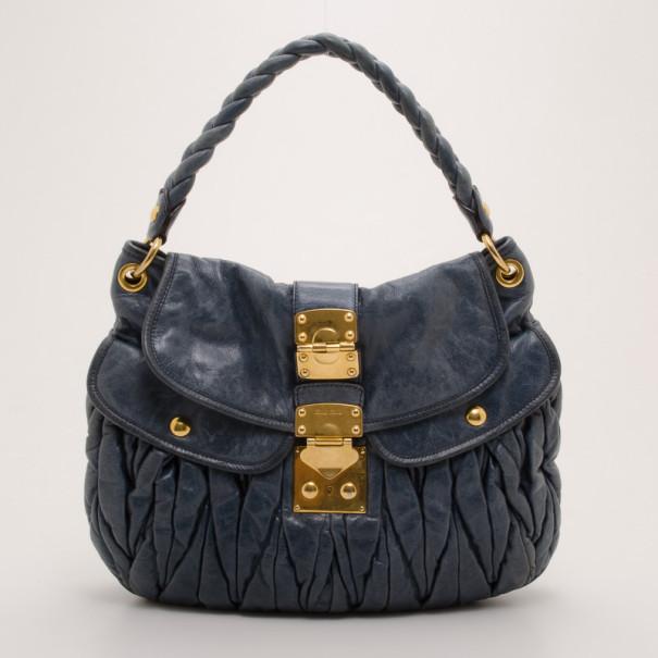 4f41773a8629 Buy Miu Miu Blue Leather Coffer Bag 37075 at best price