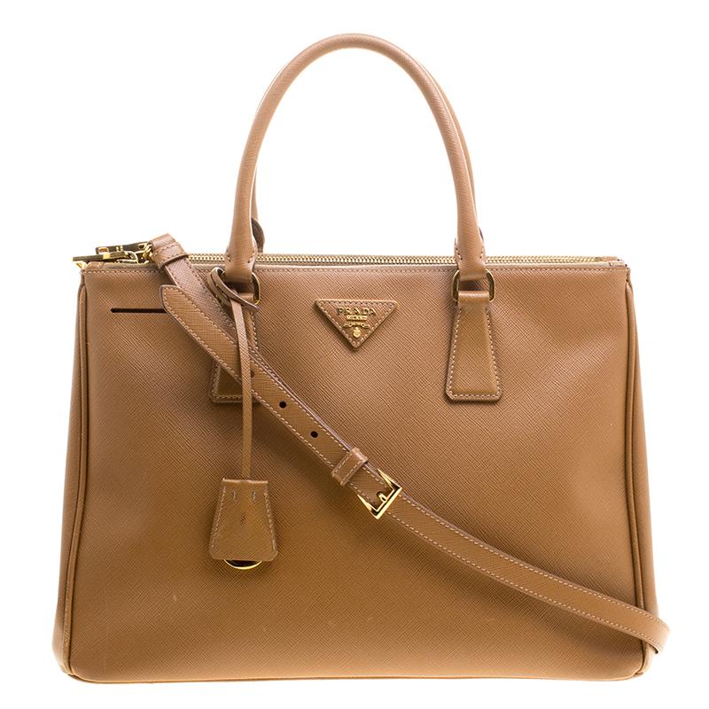 8156ca9eebb7 ... Prada Brown Saffiano Lux Leather Medium Double Zip Tote. nextprev.  prevnext