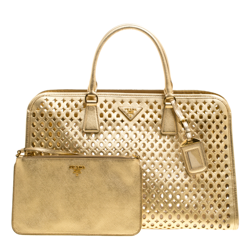 5359ce1ea55d ... Prada Gold Perforated Saffiano Fori Leather Satchel. nextprev. prevnext