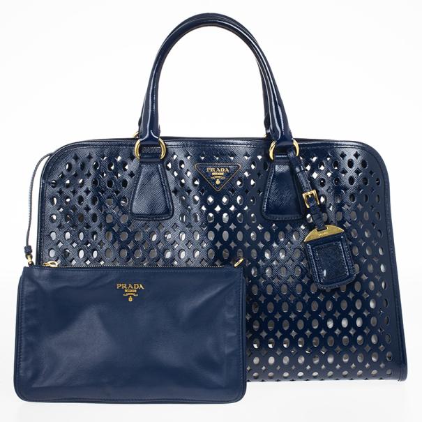 62e04ef52298 ... Prada Cut-out Saffiano Fori Laser Handbag With Pochette. nextprev.  prevnext