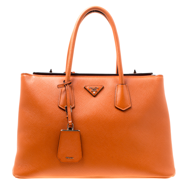 62e23586bba ... Prada Orange Saffiano Leather Medium Turnlock Twin Tote. nextprev.  prevnext