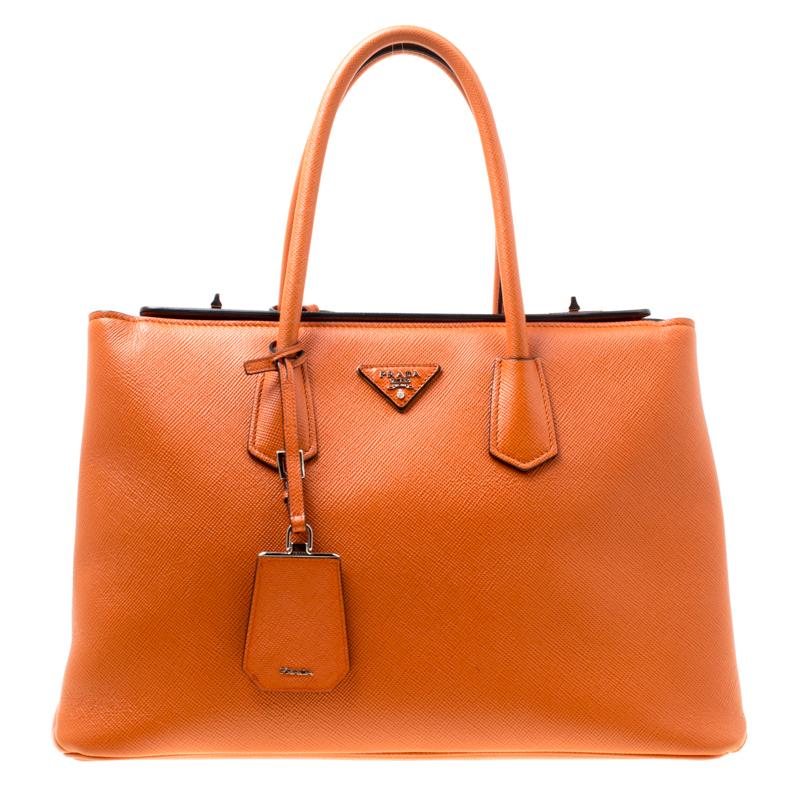 62e23586bba ... Prada Orange Saffiano Leather Medium Turnlock Twin Tote. nextprev.  prevnext