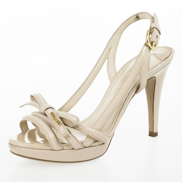 2286a0ad67a ... Prada Cream Patent Bow Platform Multi Strap Sandals Size 36.5.  nextprev. prevnext