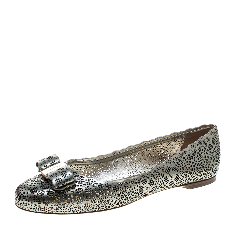 6071f93cfcc54 ... Salvatore Ferragamo Metallic Grey Perforated Leather Varina Bow Ballet  Flats Size 39. nextprev. prevnext