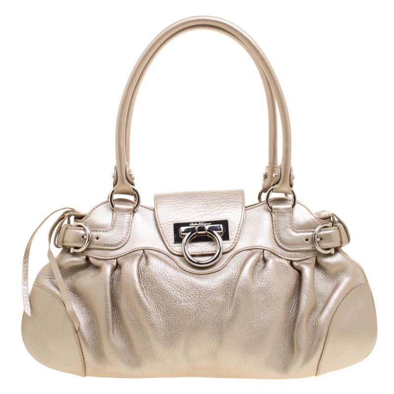 05f55387cc ... Salvatore Ferragamo Gold Leather Marisa Shoulder Bag. nextprev. prevnext