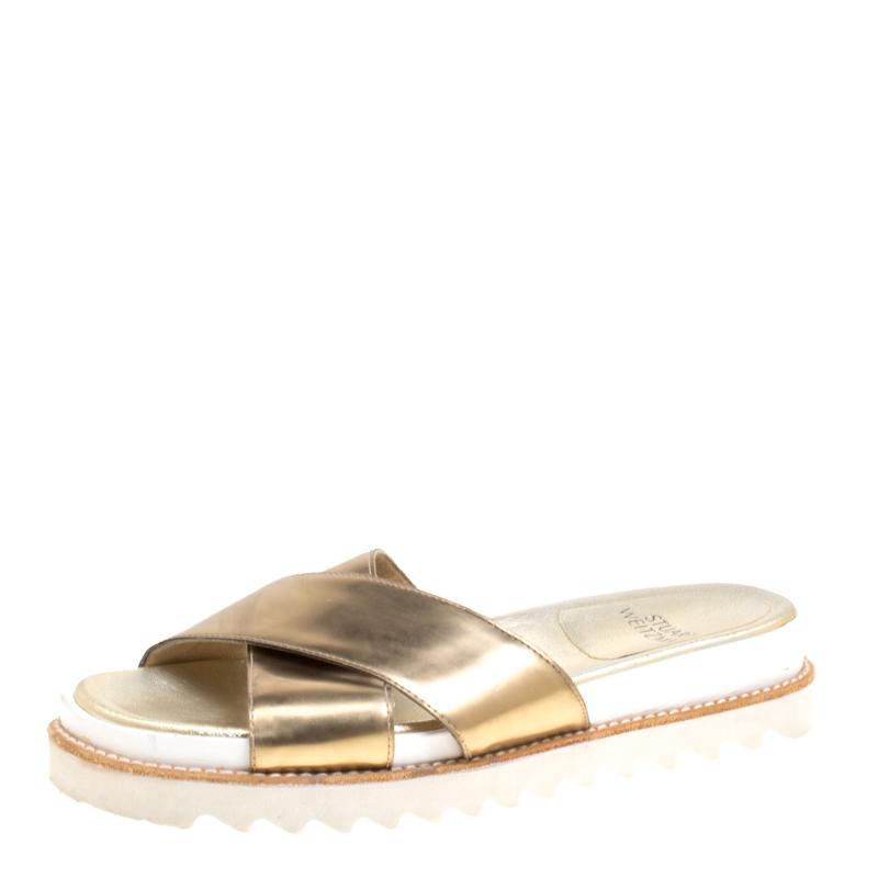 4acc791b7ed8 ... Stuart Weitzman Metallic Gold Leather Crisscross Slides Sandals Size  37. nextprev. prevnext