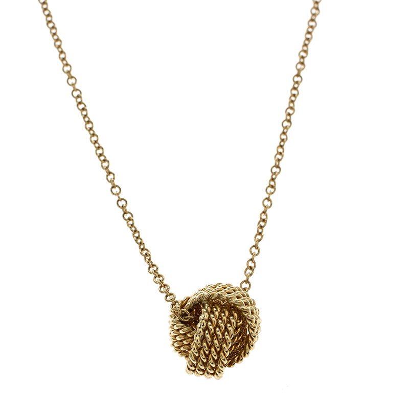a923bfa40 ... Tiffany & Co. Twist Knot 18k Yellow Gold Pendant Necklace. nextprev.  prevnext