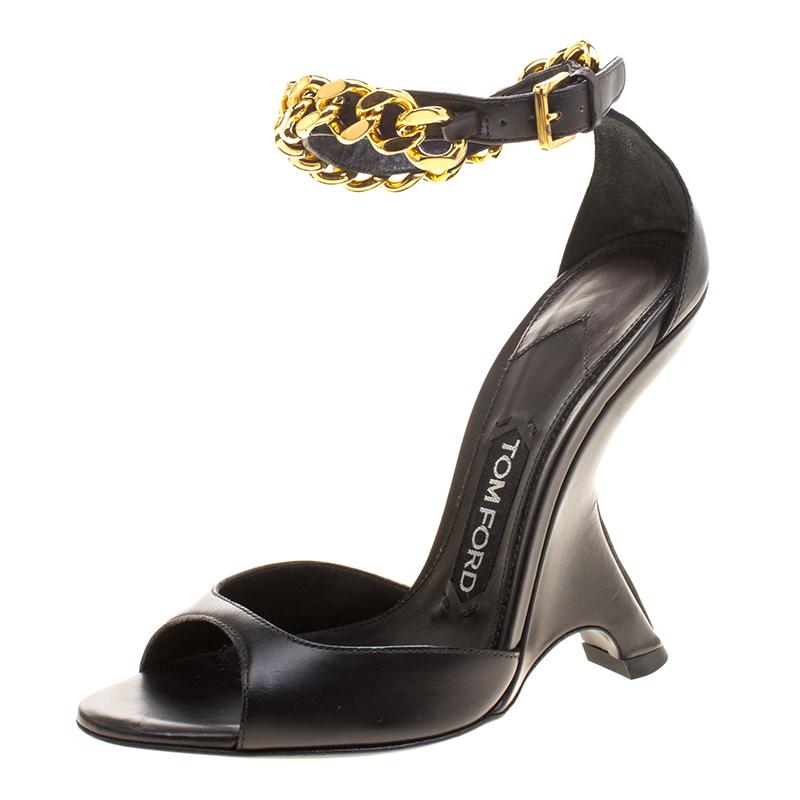 7929396781b ... Tom Ford Black Leather Chain Embellished Ankle Strap Wedge Sandals Size  36. nextprev. prevnext