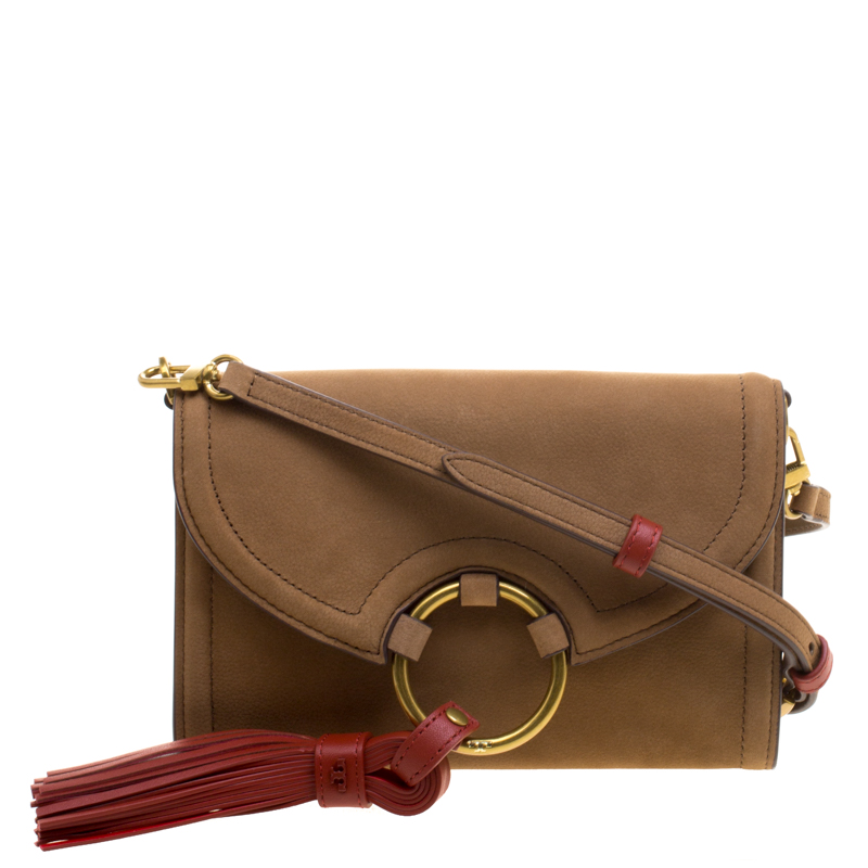 f78d11ea33a6 ... Tory Burch Brown Nubuck Leather Tassel Crossbody Bag. nextprev. prevnext