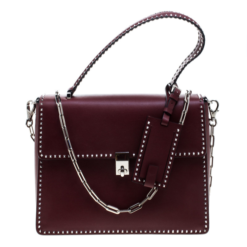 87137ced6e ... Valentino Burgundy Leather Studded Micro Rockstud Top handle Bag.  nextprev. prevnext