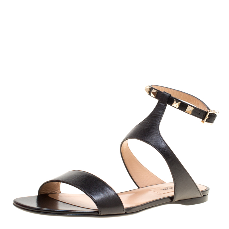 18ceb341594 Buy Valentino Black Leather Rockstud Ankle Strap Flat Sandals Size ...