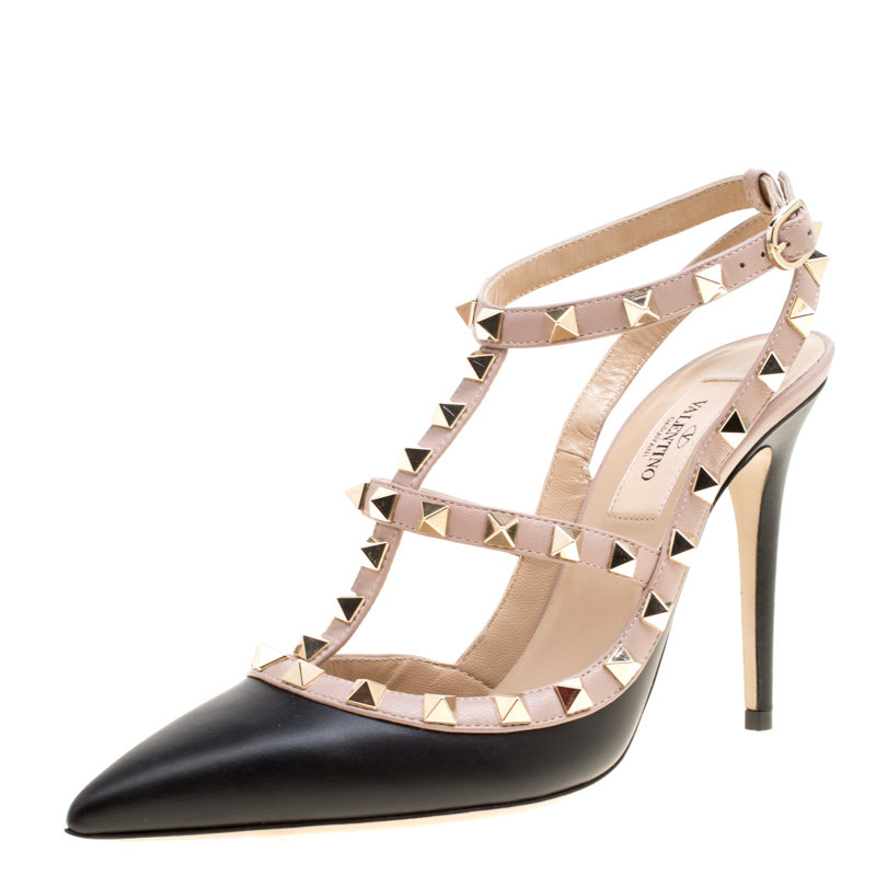 542d1280b6b8 ... Valentino Black and Beige Leather Rockstud Sandals Size 37. nextprev.  prevnext
