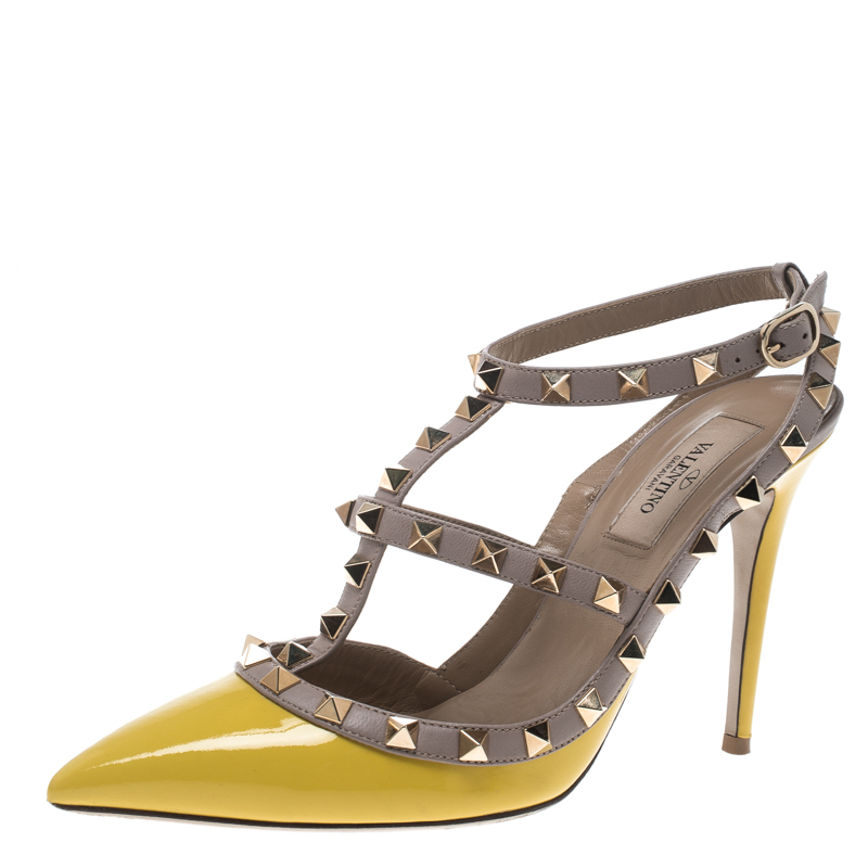 f3aa1bc82c97 ... Valentino Yellow and Beige Leather Rockstud Sandals Size 38. nextprev.  prevnext